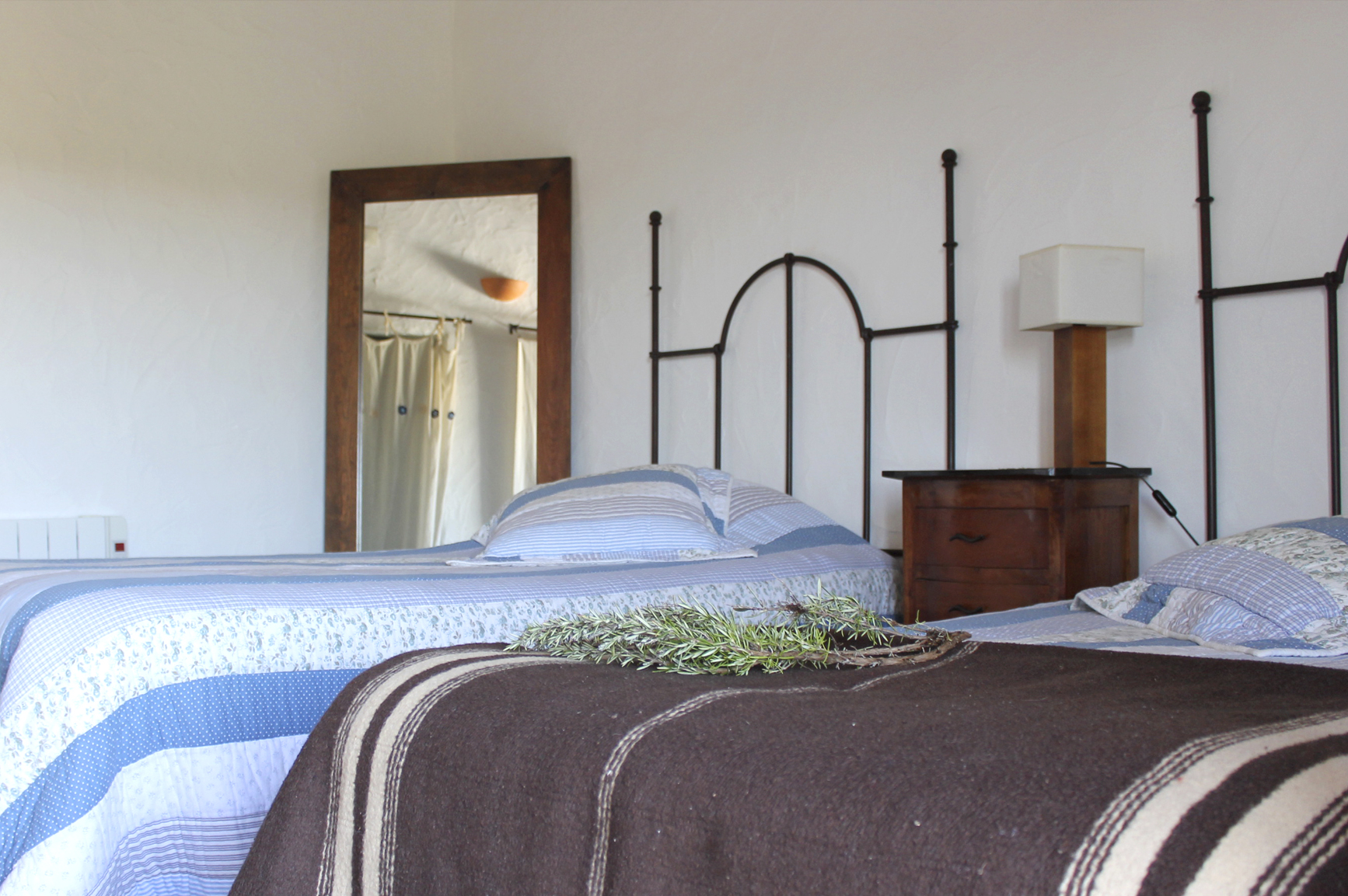 Hotel bed with bathrobe